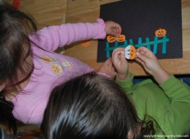 making the picture for five little pumpkins