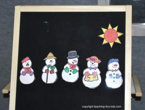 flannelboard with snowmen