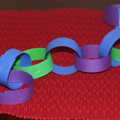 Make 1 strand of 100 rings to celebrate the 100th Day of School.