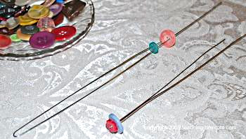 how to string buttons on the floral wire to make button flowers.