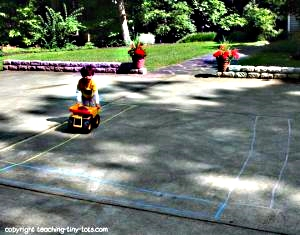 Ride on the chalk highway and reinforce following directions, building coordination and learning colors.