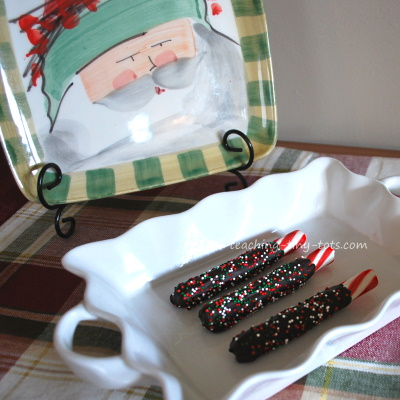 Chocolate dipped peppermint candies with sprinkles.