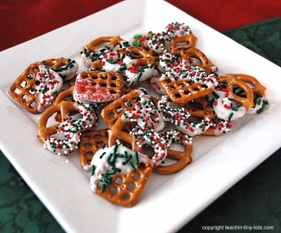 Christmas Pretzels dipped in Chocolate with Sprinkles.