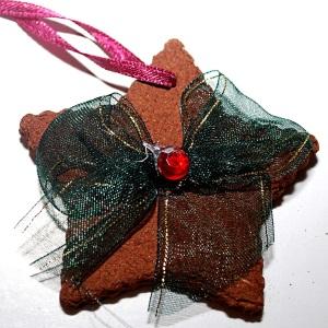 Making a cinnamon star ornament.
