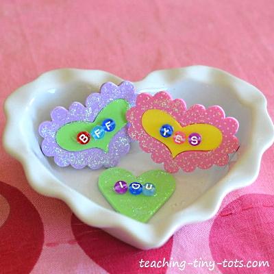 Make these cute conversation heart pin.