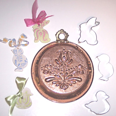 Use copper molds to print patters on salt dough.