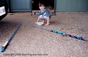 Make duck tape highways for kids to play their cars on and reinforce following directions.