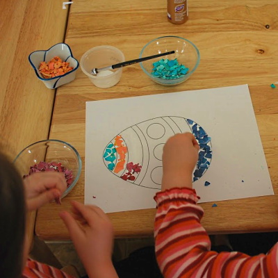Glue colored eggshell pieces onto paper design to make a mosaic.