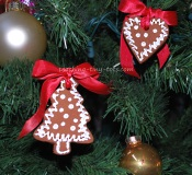 cinnamon ornaments decorated with white paint