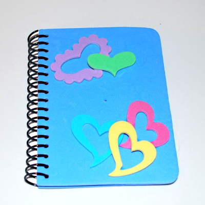 Decorating notebooks with foam stickers