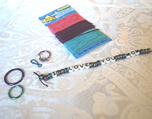 Materials to make a bead key chain.
