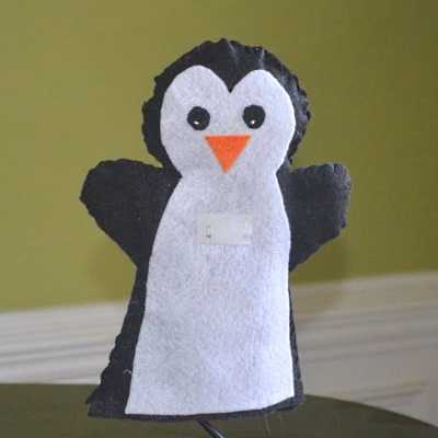 Penguin puppet made out of felt.