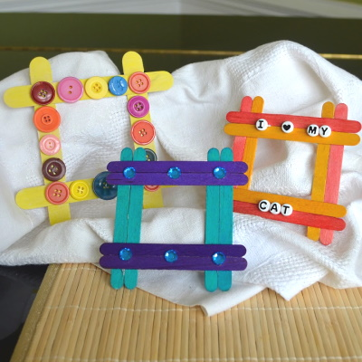 Make a cute frame from colorful popsicle sticks and rhinestone decorations.