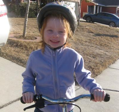 3-year-old Marlee on her balance bike.