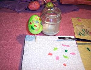 Gluing tissue on the styrofoam egg.