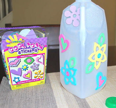 Make a watering jug using a milk jug.