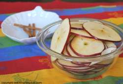 Cutting up apples to make apple chips.