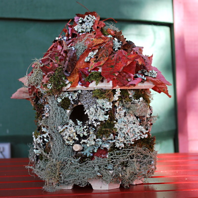 Beautiful birdhouse decorated with nature (leaves, moss)