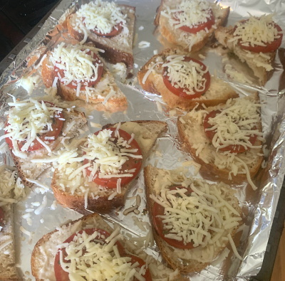 Preparing the bruschetta toast.