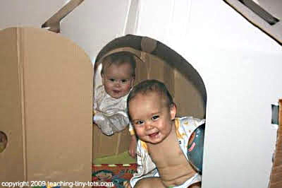 Make your own playhouse with a cardboard box.