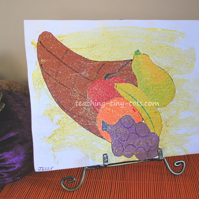 Cornucopia picture for young kids using construction paper and paint.