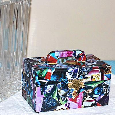 Decoupage Box with magazine pieces.