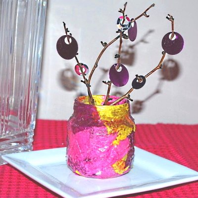 Make a decoupage jar with tissue, branches and sequins.