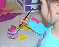 Children decoupage a jar.