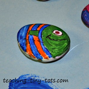 fish painted on rock