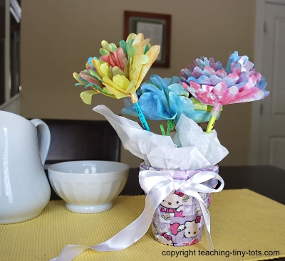 Make these pretty tissue flowers.