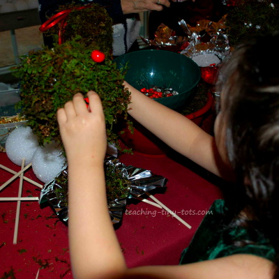Making a Christmas Moss Topiary.