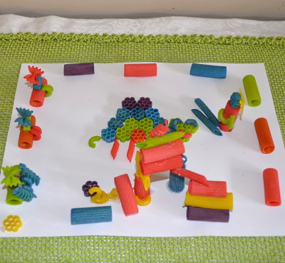 Make this cute 3-e picture, using colored pasta. This is a playground my daughter made.