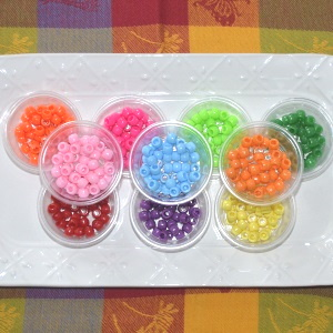 Sorting ponybeads by color.