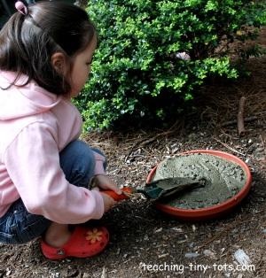 Kids making stepping stones.