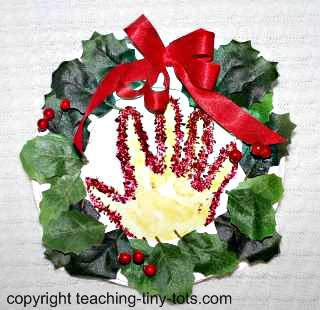 Make this cute handprint in wreath gift for Christmas.