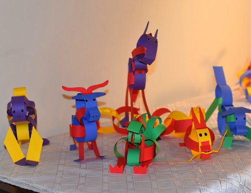 Chinese zodiac animals made with construction paper strips.