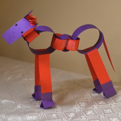 Chinese zodiac horse made of colored construction paper strips.
