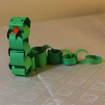 Chinese zodiac snake made of colored construction paper strips.