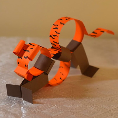 Chinese zodiac tiger made of colored construction paper strips.