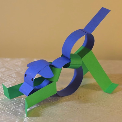 Chinese zodiac dog made of colored construction paper strips.