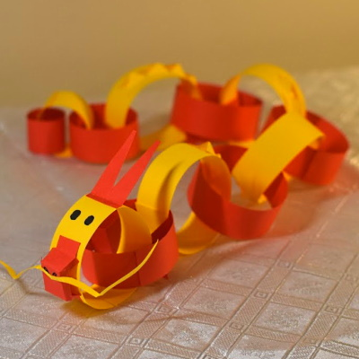 Chinese zodiac dragon made of colored construction paper strips.