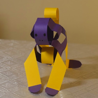 Chinese zodiac monkey made of colored construction paper strips.