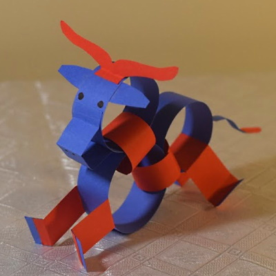 Chinese zodiac ox made of colored construction paper strips.