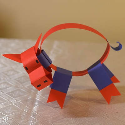 Chinese zodiac boar made of colored construction paper strips.