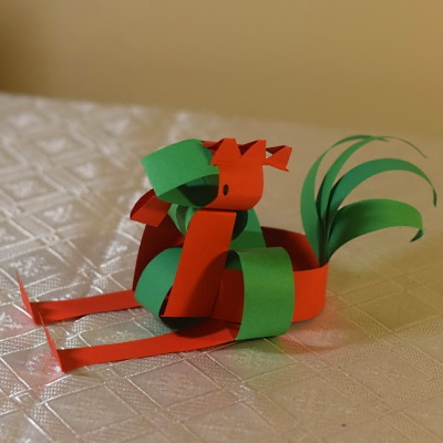 Chinese zodiac rooster made of colored construction paper strips.